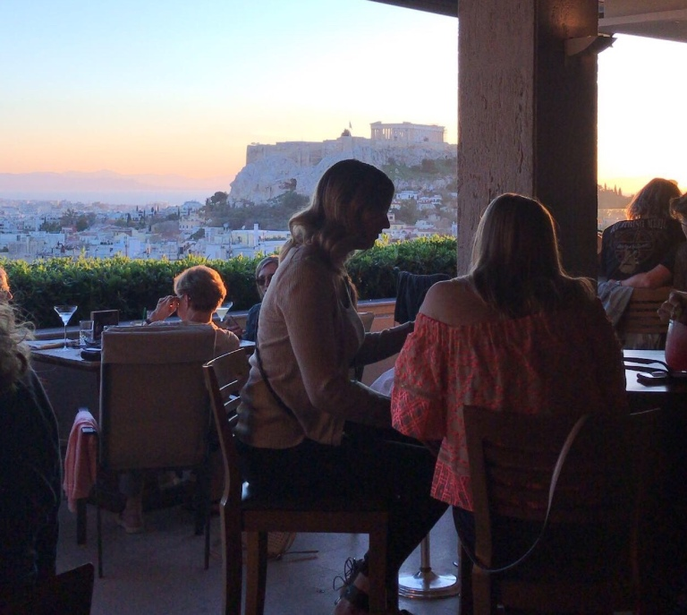Sunset over the Acropolis from a rooftop bar in Athens Greece