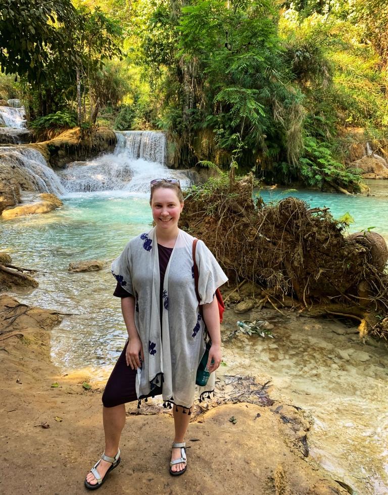 Solo female traveler at Kuang Si waterfalls in Laos