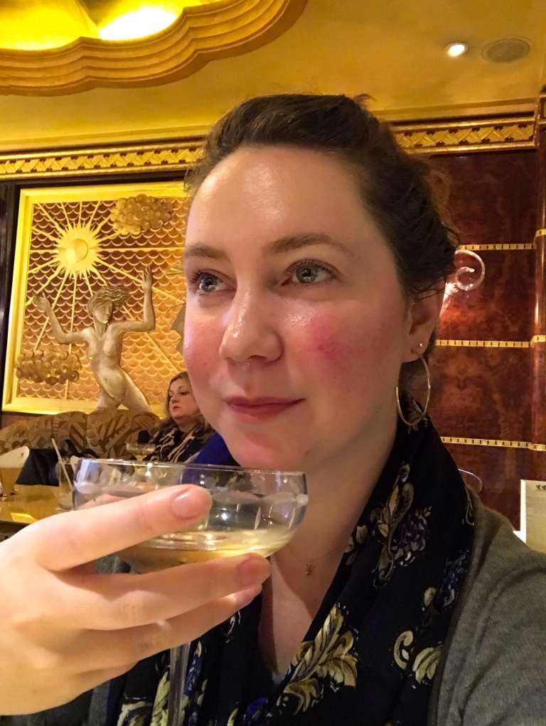 Solo female traveler drinking champagne at the Ritz in London England