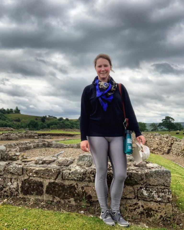 Solo female traveler on the Hadrian's Wall Vindolanda fort walk in England